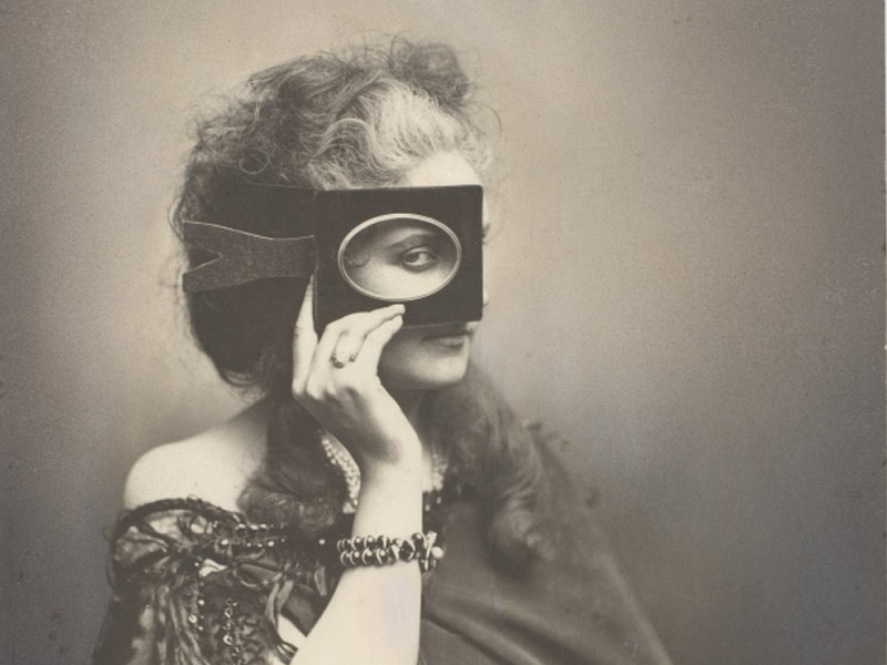 Vintage photograph of a woman looking through a picture frame
